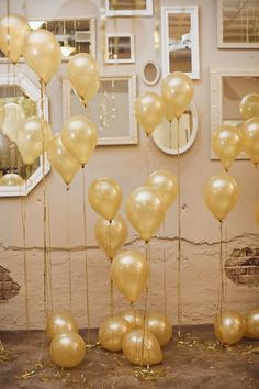 Balloons make everyone happy! Especially when they are gold. To achieve a similar look, take your string and vary the widths. Tape to the floor, so they do not swish all around. Creating a super fun party backdrop.   CreditsPhotographers:  	 Sara & Rocky Photography  View Post 	Ruffled Blog