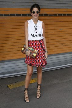 Leandra Medine of @Man Repeller in a printed skirt + strappy sandals #streetstyle