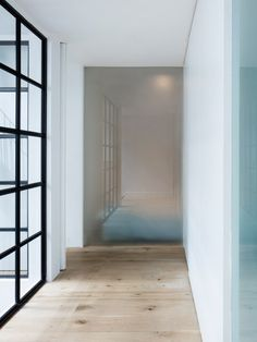 Modern warehouse conversion in Bethnal Green East London - Obscured glass partitions and Crittall steel framed atrium glazing. Steel Columns, Steel Windows, Windows And Doors, Atrium, Warehouse Plan, Street Pictures, Crittall, Warehouse Conversion, Bethnal Green