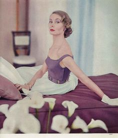 April Vogue 1951    Model is wearing a dress with a Hope Skillman piqué bodice above a pouf skirt of Wamsutta organdie, by Emily Wilkens.