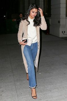 Selena Gomez's suede trench + cropped flare jeans combo is killer.