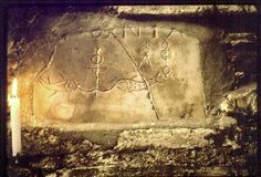 fragmentary epitaph from the catacomb of Domitilla shows fish bearing in their mouths a cross-like anchor, reminiscent of the Egyptian ankh or crux ansata.