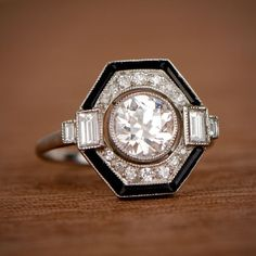 Estate Style Onyx and Diamond Engagement Ring with Old European Cut Diamond.