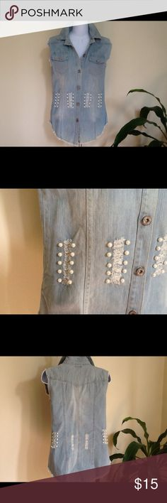 ❤ Denim Distressed Vest w/Pearls Made by Hendi USA, this denim distressed vest with faux pearls is sure to make a statement.  Made of 100% polyester, it has no stretch and runs small around the underarms.  Would recommend to size small and extra small only.  However with the ragged underarm you could cut open for more room. Tops