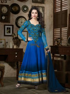 Latest, stylish, designer, floor length long Anarkali dress, looks different because of Perfect combination of shaded Blue coloured fabric and crafty touch of embroidery on chest  arms & bottom part , appropriate, exclusive & choosy patch and lace work on long-sleeves, dupatta and bottom-part has added glamour look to Indian celebrity Shraddha Kapoor.