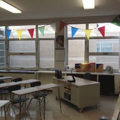 High school classroom decoration idea -- I don't like the colors, but I like the bunting banner!
