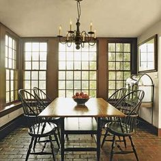 Breakfast Room - In the corner, a Wardian case - a miniature indoor greenhouse capitalizes on the natural light the room's southeast-facing, double-hung windows supply.