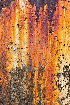 An old harbor breakwater with heavy rust and corrosion stains by © David M. Schrader