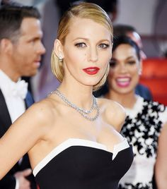 Blake Lively's Slick Side-Parted Chignon + Red Lip