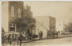 RPPC Deckerville MI Black River Street Buildings Wagons Men Pesha Photo Postcard