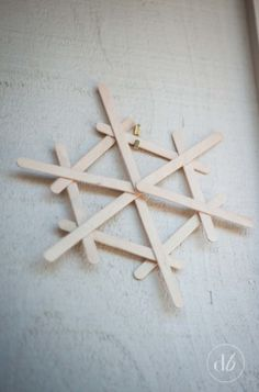 Dwell Beautiful makes some easy popsicle stick snowflakes that make for great, fun, and cheap winter decor. A great craft for kids to get in on and help out with! crafts with popsicle sticks Popsicle Stick Snowflakes - Dwell Beautiful Kids Crafts, Christmas Crafts For Kids, Diy Christmas Ornaments, Holiday Crafts, Diy And Crafts, Christmas Christmas, Easy Ornaments, Spring Crafts, Easy Crafts
