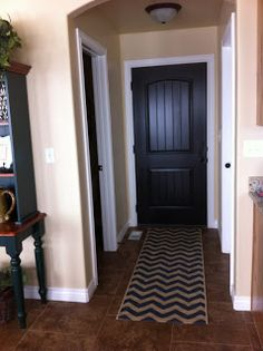 how to paint an interior door black... Need to learn this.. Gray walls, white trim, black floors & doors..
