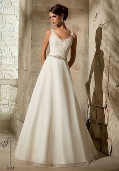 the one - tailored at the hips so the a-line starts lower Mori Lee by Madeline Gardner Blu Collection 2015