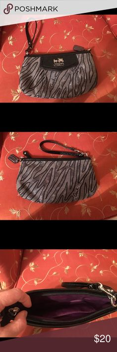 💕Coach animal print wristlet💕 This is a cute Coach animal print wristlet. It's bigger and can fit more stuff. It still has a lot of life left in it. Thanks for looking ❤️ Coach Bags Clutches & Wristlets