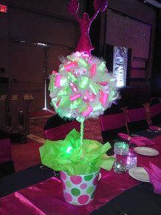 10 kids tables had ribbon topiaries with a Pink cheerleader top. We kept the feel of nightclub by inserting green glo sticks in the base with tissue paper and one under the cheerleader. Each centerpiece felt like is was under black lights in the room when the lights were lowered Black Wedding Themes, Pink Wedding Theme, Dream Wedding, Ribbon Topiary, Topiary Trees, Topiaries, Cheerleading Crafts, Pink Panther Theme, Banquet Centerpieces
