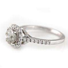 Ornate Diamond Halo Engagement Ring She will love this halo engagement ring with a 1.22 carat round brilliant diamond center, accented by a gorgeous diamond halo and band!  1.60ctw