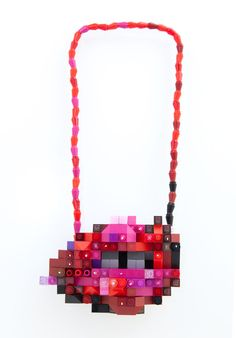 Lip1: Lips Like Sugar Kisses, from series Under the Killing Moon, emiko oye, 2015. Made from repurposed LEGO, Argentium silver, rare earth magnets. Converts into necklace and wall sculpture.