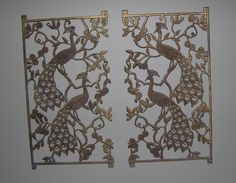 These brass peacocks are a perfect example of the odd bits and pieces I love. I found them in a thrift store and think they came from a fireplace door, but it's only a guess. They hang on the wall that connects our master bedroom to the master bath. A pair of Tsanya prints hangs on each side.