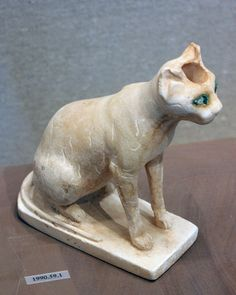 """ca. 1990–1900 B.C.E. The sculptor shows its natural physical traits, giving the animal the alert, tense look of a hunter rather than the elegant aloofness seen in later representations.  The rock-crystal eyes, lined with copper, enhance the impression of readiness. paint. H. 5 1/2 """"; L 5 3/8 in; W. 2 7/16 in."""