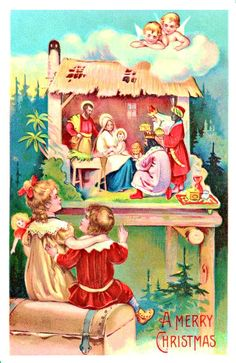 children with manger scene and angels at Christmas