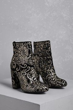 A pair of velvet ankle boots featuring an allover sequin and embroidered Baroque-inspired floral design, an almond toe, back zipper closure, and a chunky heel.<p>- This is an independent brand and not a Forever 21 branded item.</p>