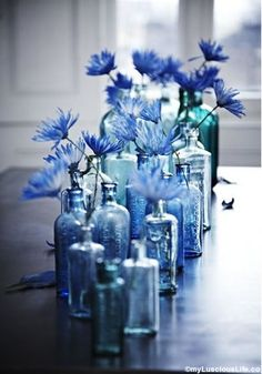 Love the idea of decorating with indigo? I'm sharing all the different ways you can bring this beautiful color into your home! Even if you're not normally a color lover, indigo can be the perfect Blue Is The Colour, Gray Color, Blue Wedding Centerpieces, Wedding Decorations, Bottle Centerpieces, Flower Centerpieces, Table Decorations, Bottle Decorations, Winter Centerpieces
