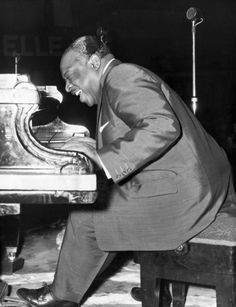 """Count Basie (American jazz pianist organist bandleader) After years of entertaining others with his jazz piano he went on his own to form the Count Basie Jazz Orchestra which entertained audiences for fifty odd years. The albums he is noted for are """"Basie At Newport"""" and """"Ella and Basie."""" The songs he is known for are Everyday (I Have the Blues), April In Paris and One O'Clock Jump."""