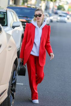Hailey Bieber knows her way around a suit—especially this red one she paired with a grey sweatshirt and white sneakers. Tap for all the details. suit Hailey Bieber's Cool Girl Guide to Suiting Estilo Hailey Baldwin, Hailey Baldwin Style, Looks Chic, Looks Style, My Style, Look Fashion, Fashion Outfits, Womens Fashion, Fashion Style Women