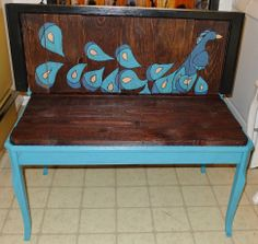 This is a peacock pallet bench.  I made from an old window, pallet wood and an old table. I hand painted it, stained it and added some polyurethane.  It is rustic and pretty at the same time