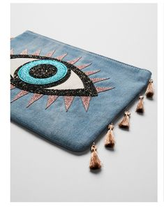 Whether on vacation, out to dinner or just running errands, this denim, tassel-trimmed pouch keeps keys, cards and makeup all in one fun place. Beaded Embroidery, Hand Embroidery, Diy Clutch, Diy Purse, Evil Eye Jewelry, Handmade Bags, Cool Eyes, Diy Clothes, Hamsa