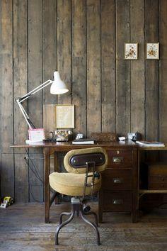 Vintage work desk. Love the wood walls