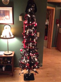 Sorry this isn't art but, this is our Christmas tree... Yes it's all Star Wars and yes it has a cape. This isn't our main tree, but my dad wanted to do something in honor of episode 7. lol I'm a HUGE Star Wars fan! XD   ~Maya~