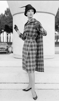 1957 Model is wearing wool tartan dress with cape-like panel, Rome