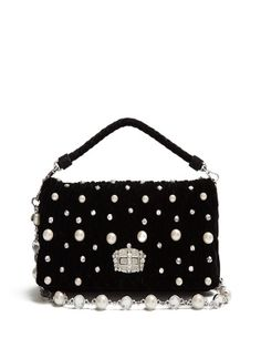 Miu Miu's black quilted-velvet shoulder bag sparkles with clear crystals and faux-pearls. It opens to a suede and satin-lined interior that has plenty of space for your smartphone, cardholder, and make-up compact. Make it your new evening favourite.