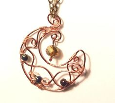 Crescent moon pendant is made of antique copper color wire, tiny seed beads are rainbow metallic colors, middle has clear seed beads and the dangle bead is an amber color faceted Rondelle bead. Copper Wire Jewelry, Moon Jewelry, Moon And Star Earrings, Moon Necklace, Jewelry Making, Diy Jewelry, Jewelry Rings, Wire Wrapped Earrings, Jewelry Design