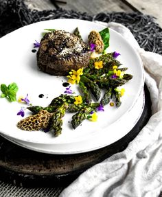 Prime-grade Filet Mignon. Seared to tender mouthwatering mid-rare perfection. Plated with grilled asparagus tips morel mushrooms fresh flowers & herbs.  Blog: http://ift.tt/1vCV6pv  #firemakeseverythingbetter #steak #beef #tenderloin #beefitswhatsfordinner #paleo #grill #bbq #instagood #food #foodpics #foodstagram #paleo #glutenfree #bacon #beer #smoke #getinmybelly #nomnom #recipe #backyardbbqhero #likeaboss #grillporn #steakporn #puremichigan #chef #outdoorchef  @buzzfeedfood @beautifulcui...