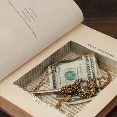 Secret Storage Books because hiding a $1 was never so vital!