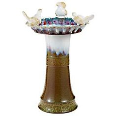 This is a lovely ceramic birdbath with a reactive glaze.  I can't afford it now but can wait to see if it comes on clearance at the end of season.  Can I hide it in the stockroom? No, I really wouldn't do that but it it sweet.