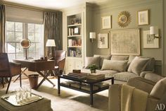 Painted in a Benjamin Moore gray, the master sitting room contains a sofa by Nancy Corzine and a cocktail table by Kasler for Hickory Chair. Architectural Digest; photo by Pieter Estersohn
