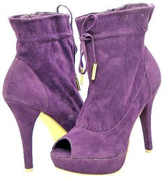 Purple tie front bootie with open toe. Pair with paneled jeggings, a black circle top, and a silver or gold statement ring or bracelet.