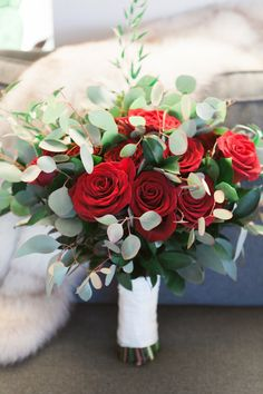 Gorgeous bridal bouquet with red roses and eucalyptus. Contact Marion at Bayview Florist Wedding Studio in Sayville, NY. Maz851@aol.com