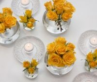 BY EVENT SCENE ADELAIDE. Stunning yellow roses with our unique candle holder collection creates a beautiful centrepiece / table-scape for large or small tables.
