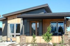 Modern Style House Plan - 3 Beds 2 Baths 1489 Sq/Ft Plan #895-31 Exterior - Front Elevation - Houseplans.com