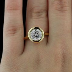 How about this modern bezel paired engagement ring with a classic round cut!
