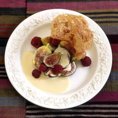 Whipped cream delicately flavored with lavender honey is spooned over fresh figs and raspberries. Lacelike almond cookies are served alongside the fruits and cream to provide a contrasting crunch.