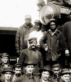 African-Americans working as part of a locomotive crew for the Illinois Central, ca. 1920.