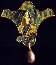 René Lalique. 1897 'Peacock Lady' Brooch. A gold curving plaque, set with a profile of a girl holding stylized leaves or peacock feathers, her flowing hair and background in blue and green enamel, the hair twisting below into a openwork spiral motif, suspending a black cultured pearl. The reverse in seagreen enamel, mounted in 18k gold