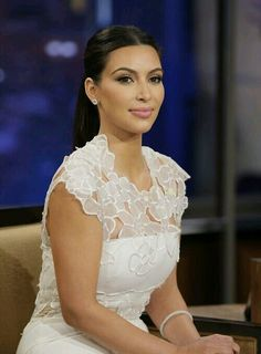 94c1253712f3c So elegant floral lace dress on Kim Kardashian. Looks just like a young  woman I…