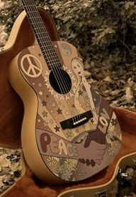 This is my real life guitar.  I painted it myself.  I escape from the world by playing my guitar!