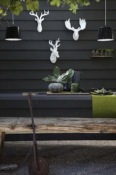Drill wood into the brick and paint it black/charcoal. Add a wood railing and paint to match.
